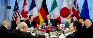U.S. President Barack Obama (C) participates in a G7 leaders meeting during the Nuclear Security Summit in The Hague March 24, 2014. At the table are the President of the European Council Herman Van Rompuy, French President Francois Hollande, British Prime Minister David Cameron, Obama, German Chancellor Angela Merkel, Japanese Prime Minister Shinzo Abe, Italy's Prime Minister Matteo Renzi and President of the European Commission Jose Manuel Barroso (L-R, clockwise). REUTERS/Jerry Lampen/Pool (NETHERLANDS  - Tags: POLITICS)   - RTR3IEYO